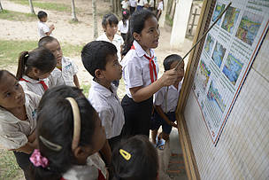 Students read local laws on fish and water conservation at Baan Loppadeekhonennoy, Khong District, Champassak Province, Laos.