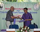 Mr. Guenther Meyer of WWF and Pongint Rukariyatum, PhD, Assoc. Professor, exchange the MOU.