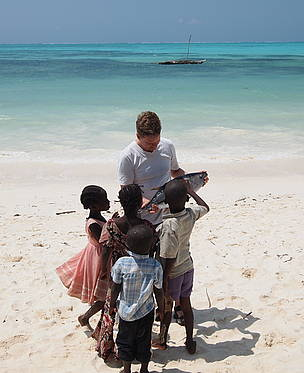children on the beach. Small-scale fisheries (reef-fish, whitefish and tuna) in Stonetown, Zanzibar, Tanzania