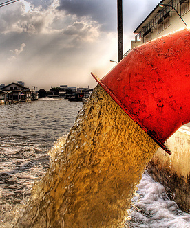 Untreated sewerage pours into a river in Bangkok, Thailand.   	© Trey Ratcliff