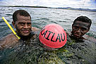 Naduri village youths with the buoy that marks the boundary of the new marine protected area.