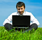 Man with laptop      © iStockphoto/ZoneCreative