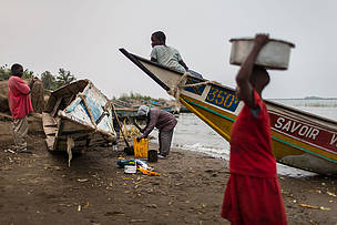 Villagers fixing a boat in Vitshumbi fishing village on the southern shores of Lake Edward, in the