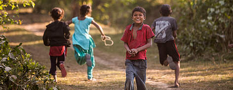 Young children play in Dhoteri, Khata corridor, near Bardia National Park, Nepal. rel=