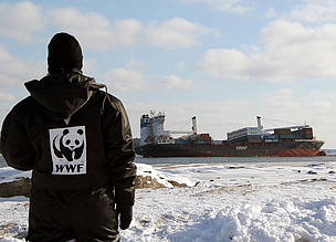 A WWF Norway staff member observes the Godafoss oil tanker, which has run aground near Oslo.
