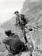 Fritz Vollmar standing on a mountain side.
