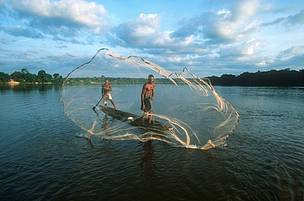 Fishermen with cast net fishing on the Dzanga River, Central African Republic